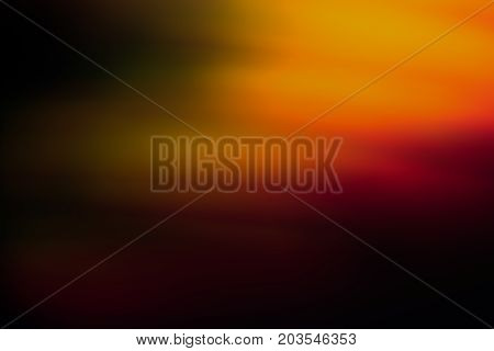 Abstract background of blurred orange, green and red light blur. Bokeh of defocused lines in motion, aurora skylights wallpaper, magic of nature around