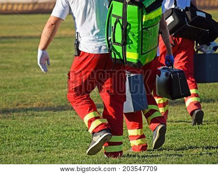 Ambulance staff with equipments on the sport field