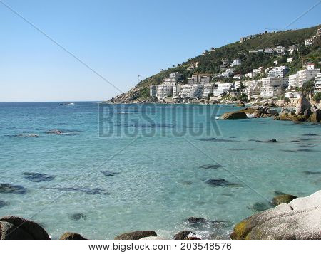 FROM  CAPE TOWN, SOUTH AFRICA, WITH THE CALM TURQUOISE WATER OF CLIFTON