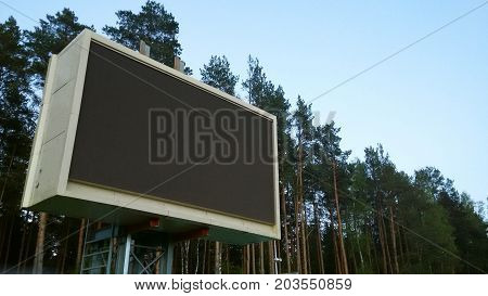 Modern street sport arena scoreboards in the woods on the nature