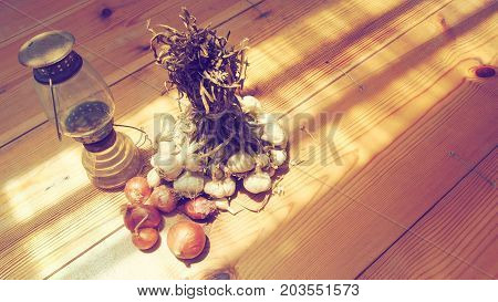 Background atmosphere retro and oblique concept vintage art has garlic red onion Kerosene lamp on wood has copy space