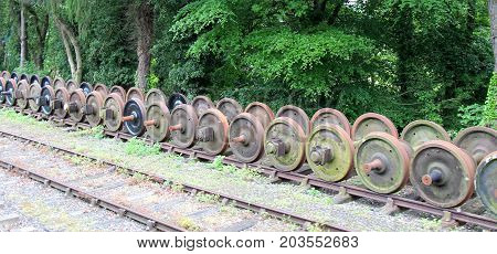 Storage of a Collection of Old Railway Train Wheels.