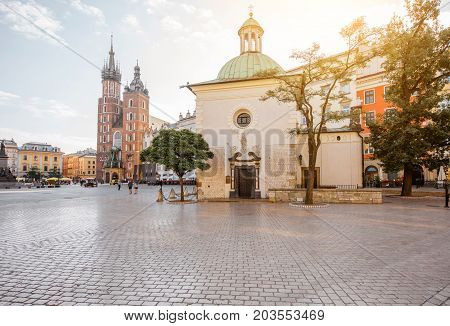 View on the Market square with saint Marys and Adalbert's church in Krakow during the morning light in Poland