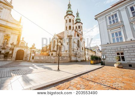 View on the square of Saint Mary Magdalene with saint Andrew's church in Krakow during the sunrise in Poland
