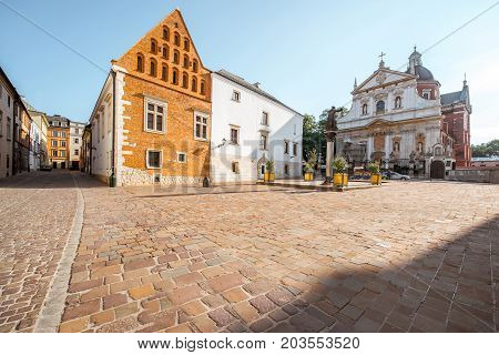 View on the square of Saint Mary Magdalene with saint Peter and Paul church in Krakow during the sunrise in Poland
