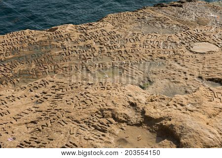 Carved And Engraved Names In The Rock