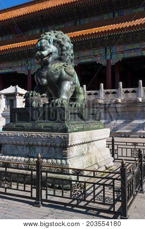 Statue of a Chinese Guardian Lion at the Forbidden City in the city of Beijing in China