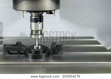 The Measurement probe attach on CNC's machine calibrate with ring gauge.Quality control precesss on CNC machine.
