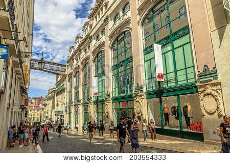 Lisbon, Portugal - August 26, 2017: iron structure of Santa Justa Elevador also called Carmo Lift and access deck from Rua do Carmo in Baixa Distric, Lisbon. People walking in downtown portuguese.