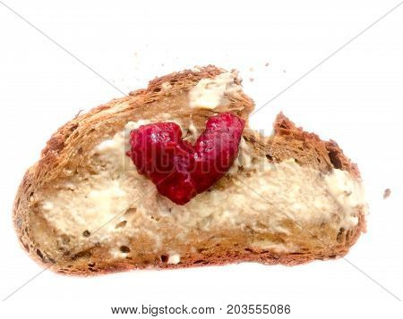 Bread with butter and red heart shape marmelade love symbol. Delicious strawberry or raspberry breakfast surprise present for Mother's Day girl or boy friend at Valentine's Day or anniversary. Isolated on white background.