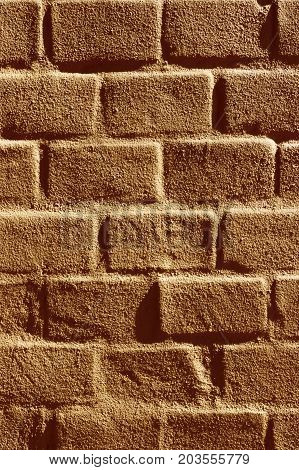 Brick wall painted brown in sunlight textured background