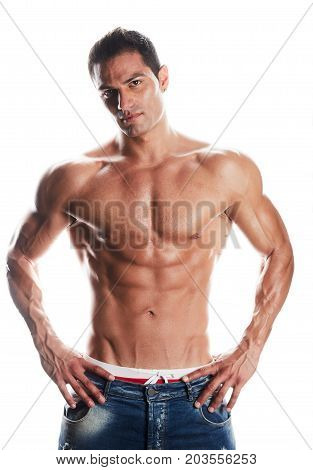 young man body building posing on white background