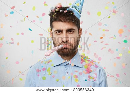 Unhappy Birthday Guy With Stubble Feeling Sad And Disappointed Because Nobody Came To Celebrate His