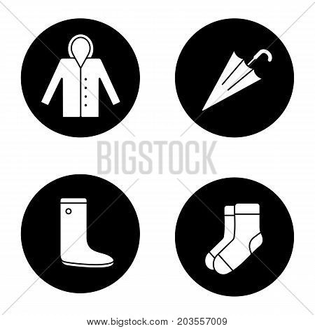 Autumn weather glyph icons set. Raincoat, warm socks, watertight, closed umbrella. Vector white silhouettes illustrations in black circles