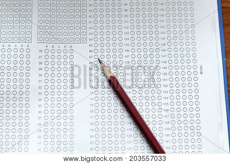 Glasses And Pencil On Standardized Test Form With Answers Bubbled In And A Pencil, Focus On Answer S