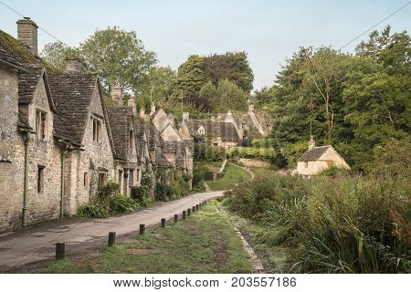 Medieval Houses In Arlington Row In Cotswolds Countryside Landscape In England