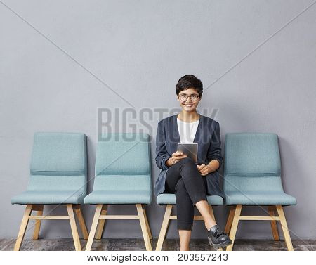 People, Employment And Recruitment. Charming Happy Young Unemployed Woman In Glasses Smiling Broadly