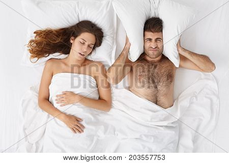 People, Family, Bedtime And Insomnia Concept. Unhappy Bearded Man Having Sleepless Night Because Of