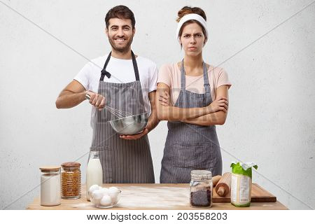 Young Man And Female Demonstrating Their Cooking Talents On Tv Programm, While Cooking Cake For Birt