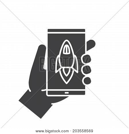 Hand holding smartphone glyph icon. Silhouette symbol. Smart phone boost app. Negative space. Vector isolated illustration