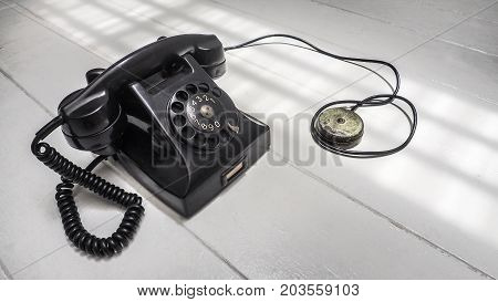Telephone set antique black color dial system communication Isolate on white wood floor has copy space.