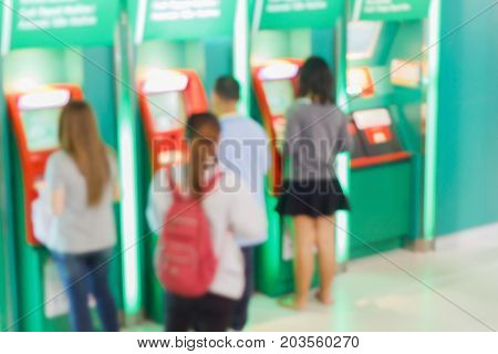 Blurred Of People Stand In Line To Withdraw Money At Atm