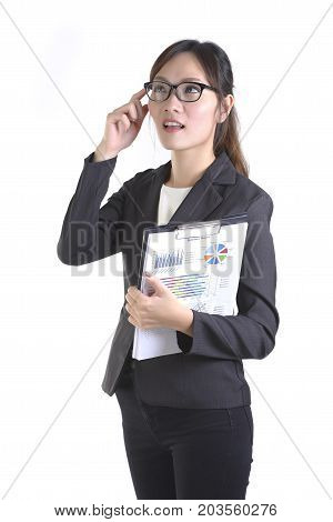 Business women in business suit holding black folder with paperwork on pure white background.