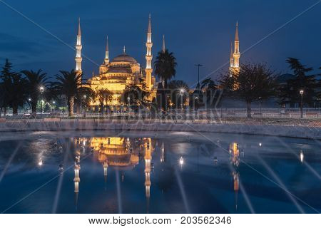 Fountain in sultanahmet area in morning time. Multicolored streams against the background of the Blue mosque. Located place: Istambul Turkey