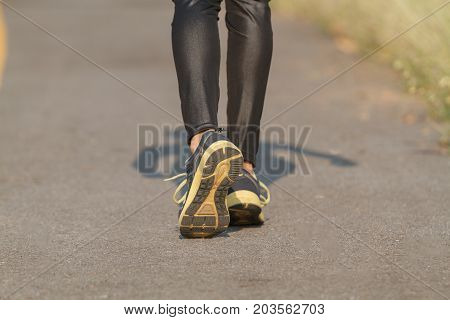 Blurry And Soft Focus Of Running Woman. Female Asian Runner Jogging During Outdoor On Road .