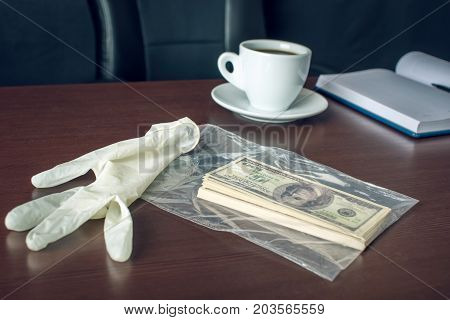 Bribe On The Table In The Form Of Dollar Bills. Caught Red-handed And Evidence Of The Crime. Corrupt