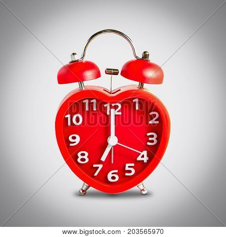 Red double bell alarm clock isolate on gray background