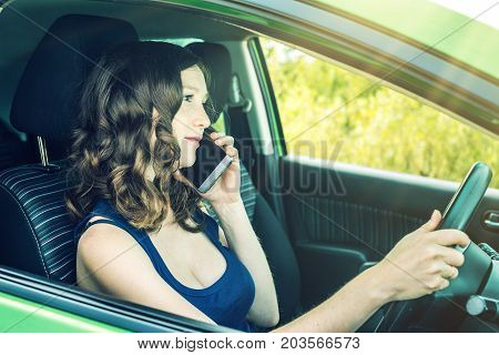Woman Driver Talking On A Phone In The Car. Distracted And Dangerous Driving. The Traffic Violation.