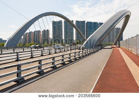 Chengdu, Sichuan Province, China - Aug 8, 2017: Traffic on a butterfly shaped highway bridge in Chengdu south Century City district.
