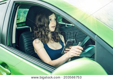 Driver Woman With A Phone In Hands Makes An Accident. Fright, Inconsiderate And Dangerous Driving. T