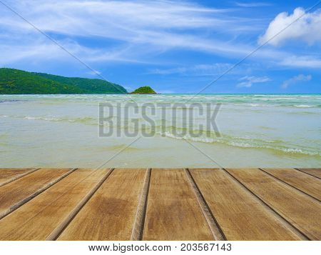Wooden table in front of abstract sea background. For present your products. Summer Concept