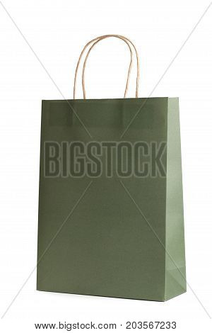 Paper shopping bag mockup template isolated on white background. Green color. Packet for gift or present.