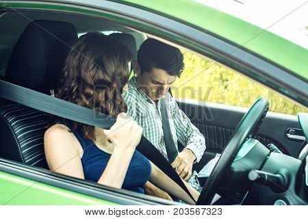 The Woman And The Man In The Car Wear A Seat Belt. Concept Of Road Safety And Observance Of Traffic