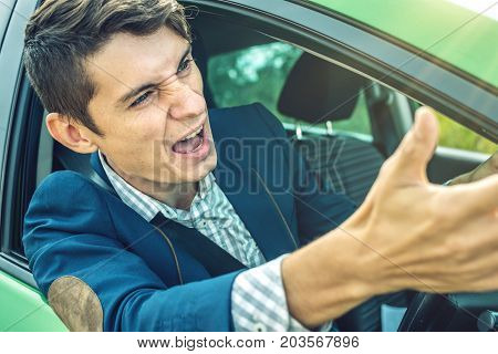 Angry Man Driver Screaming In The Car. Quarrel And Dissatisfaction On The Way.