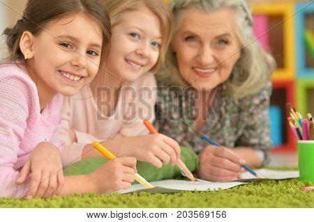 grandmother and granddaughter doing homework, together at home
