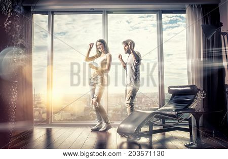 Happy couple in their new Penthouse dancing together
