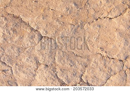 Texture of the ground soil close-up broken ground background