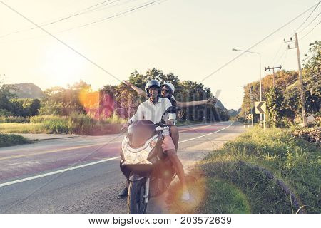 Happy Couple Riding Motorcycle In Countryside Excited Woman And Man Travel On Motorbike Summer Road Trip Concept