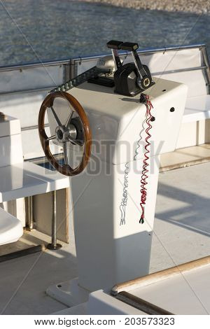 BUDVA, MONTENEGRO - AUGUST 07, 2017:Ship's steering wheel and control point on the boat.