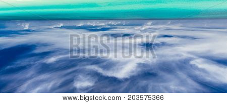 abstract amazing gorgeous view of upside down tranquil turquoise ocean fragment and deep dark blue sky background