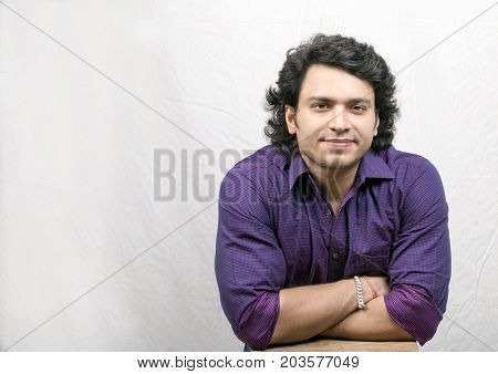 indian boy in check purple shirt smiling closup pose