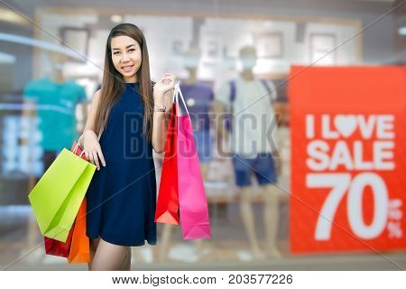 Happiness, Consumerism, Sale And People Concept - Smiling Young Woman Asian With Shopping Bags Over