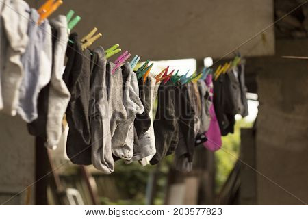 colorful socks hanging on a rope with blurred background