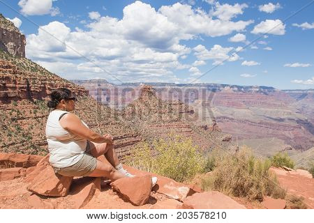 Asian woman enjoying the view of the Grand Canyon from the Bright Angel Trail