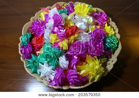 Set ribbon folded into a flower. Wrap coins by hand. for the sacred(ordination ,matriculation ,initiation) in Thailand