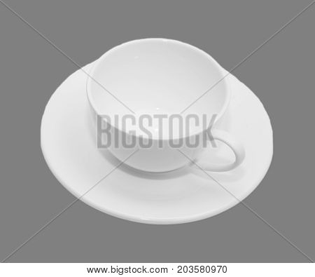 White mug and saucer on a gray background.